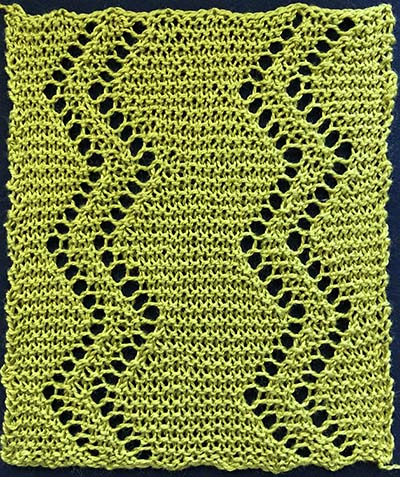 Knitted sample of a garter stitch insertion with two double rows of eyelets in a zig-zag or sawtooth pattern.